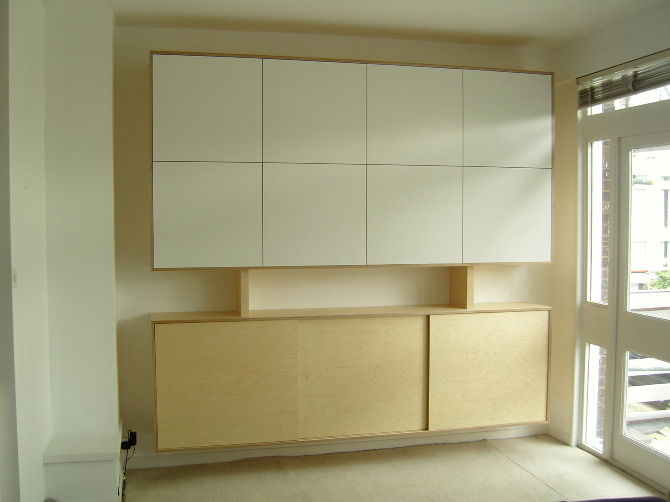 The Piece Is Constructed In Birch Plywood. Doors Laminated In A White  Formica. The Remainder Is Sprayed With A Clear Laquer.