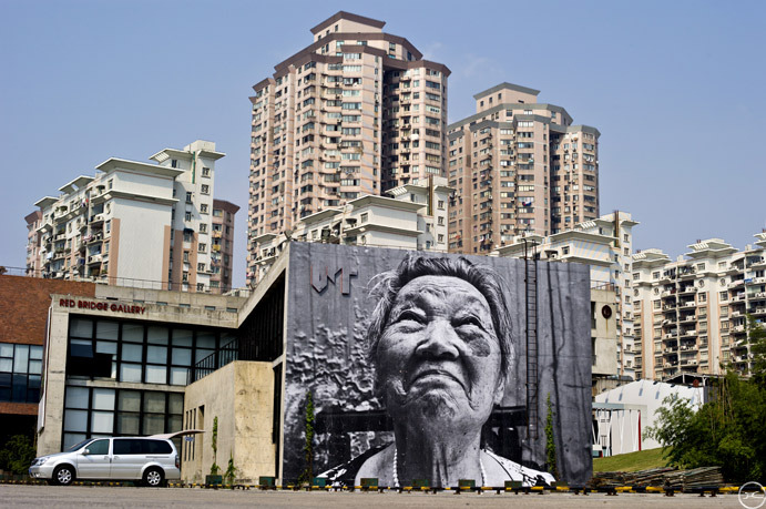 Jr in shanghai unurth street art for Mural de chine