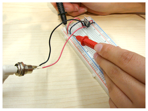 plug the power supply (dc from wall) to the power jack  switch the  multimeter to the range for reading 0-20 volts, dc  to measure voltage,  always connect