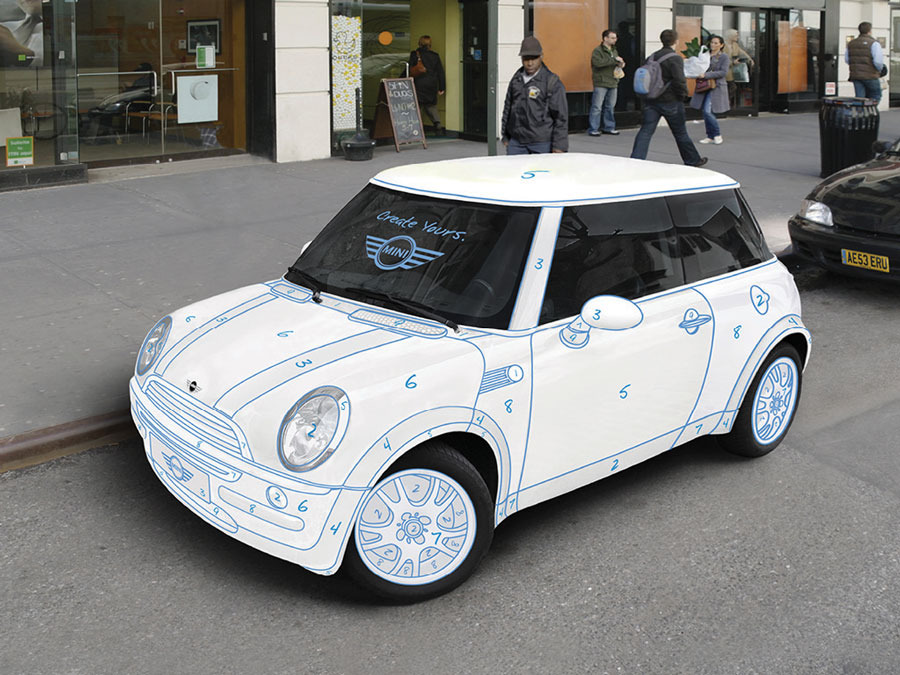 Mini Coopers painted in the classic paint-by-numbers style are parked ...